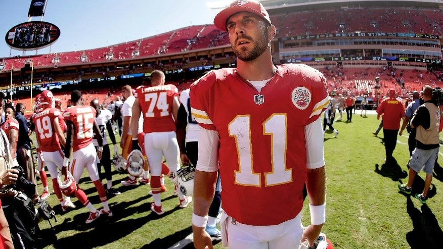 Kansas City Chiefs quarterback Alex Smith (11) walks off the field after an NFL football game against the Tennessee Titans  Sunday, Sept. 7, 2014, in Kansas City, Mo. The Titans won 26-10. (AP Photo/Charlie Riedel)