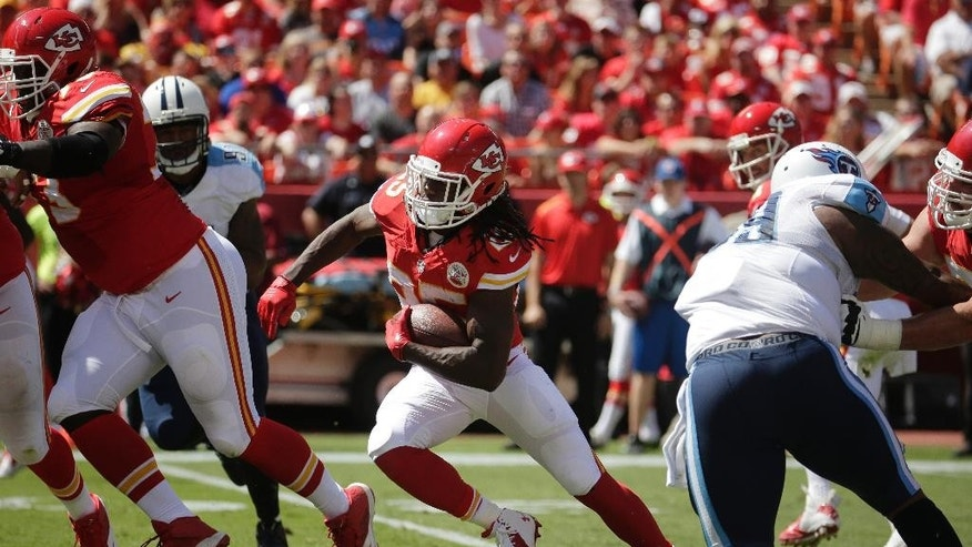 FILE - In this Sept. 7, 2014, file photo, Kansas City Chiefs running back Jamaal Charles (25) carries the ball in the first half of an NFL football game against the Tennessee Titans in Kansas City, Mo. Charles had seven carries for 19 yards and four catches for 15 yards in the season-opening loss to Tennessee, stunning numbers for the All-Pro running back. (AP Photo/Charlie Riedel, File)