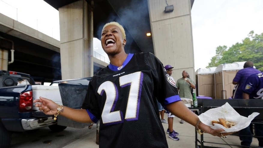 Karla Owens wears a Baltimore Ravens' Ray Rice jersey as she tailgates before the Ravens' NFL football game against the Pittsburgh Steelers on Thursday, Sept. 11, 2014, in Baltimore. (AP Photo/Patrick Semansky)