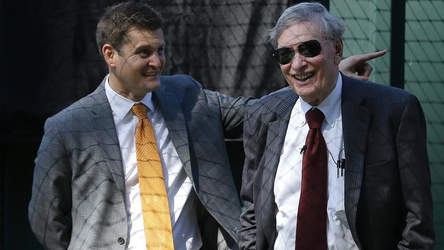Major League Baseball commissioner Bud Selig, right, smiles while touring AT&T Park with San Francisco Giants executives Alfonso Felder before a baseball game between the Giants and the Arizona Diamondbacks in San Francisco, Thursday, Sept. 11, 2014. (AP Photo/Jeff Chiu)