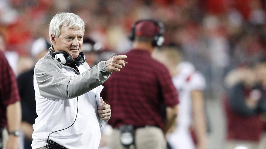 Virginia Tech head coach Frank Beamer points at his quarterback during second quarter of an NCAA college football game Saturday, Sept. 6, 2014, in Columbus, Ohio. Virginia Tech Beat Ohio State 35-21. (AP Photo/Paul Vernon)