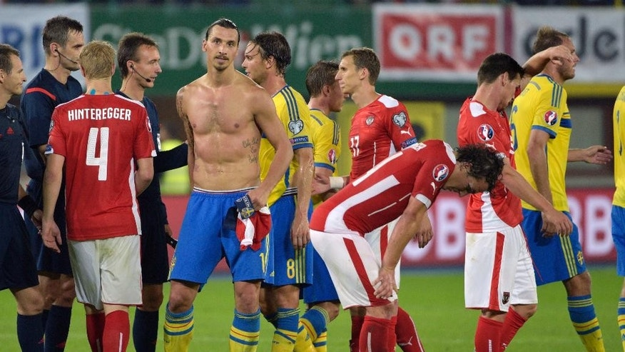 Austria's Martin Hinteregger, Sweden's Zlatan Ibrahimovic, Albin Ekdal, Pierre Bengtsson, Austria's Florian Klein, Julian Baumgartlinger, Christoph Leitgeb and Andreas Granqvist, from left, after the Euro 2016 soccer qualifying group G match between Austria and Sweden in Vienna, Austria, Monday, Sept. 8, 2014. (AP Photo/Hans Punz)