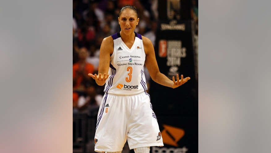Phoenix Mercury guard Diana Taurasi (3) reacts to a call in the first half of Game 1 of the WNBA basketball finals against the Chicago Sky, Sunday, Sept. 7, 2014, in Phoenix. (AP Photo/Rick Scuteri)