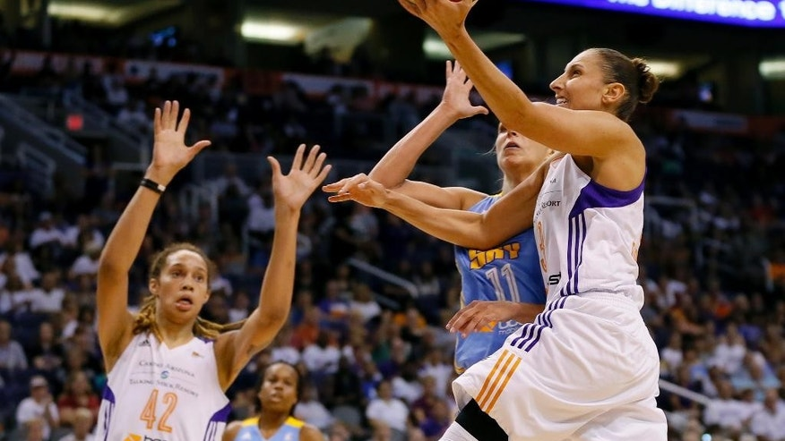 Phoenix Mercury guard Diana Taursai shoots over Chicago Sky forward Elena Delle Donne (11) during the first half of  Game 2 of the WNBA basketball finals, Tuesday, Sept. 9, 2014, in Phoenix. (AP Photo/Matt York)