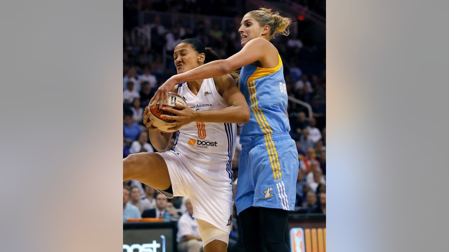 Phoenix Mercury forward Mistie Bass (8) rebounds over Chicago Sky forward Elena Delle Donne during the first half of  Game 2 of the WNBA basketball finals, Tuesday, Sept. 9, 2014, in Phoenix. (AP Photo/Matt York)