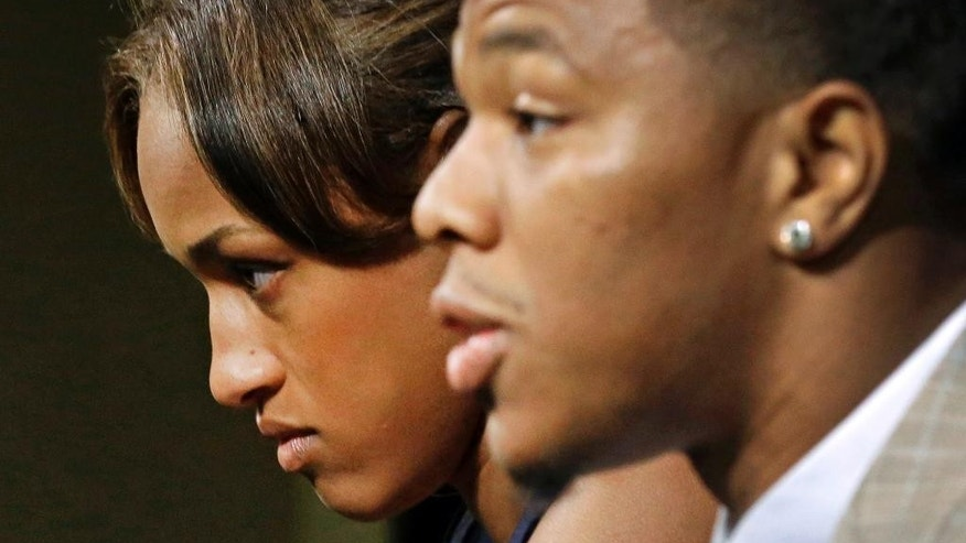 "FILE - In this May 23, 2014, file photo, Janay Rice, left, looks on as her husband, Baltimore Ravens running back Ray Rice, speaks to the media during a news conference in Owings Mills, Md. A law enforcement official says he sent a video of Ray Rice punching his then-fiancee to an NFL executive five months ago, while league officers have insisted they didn't see the violent images until this week. The person played The Associated Press a 12-second voicemail from an NFL office number on April 9 confirming the video arrived. A female voice expresses thanks and says: ""You're right. It's terrible."" (AP Photo/Patrick Semansky, File)"