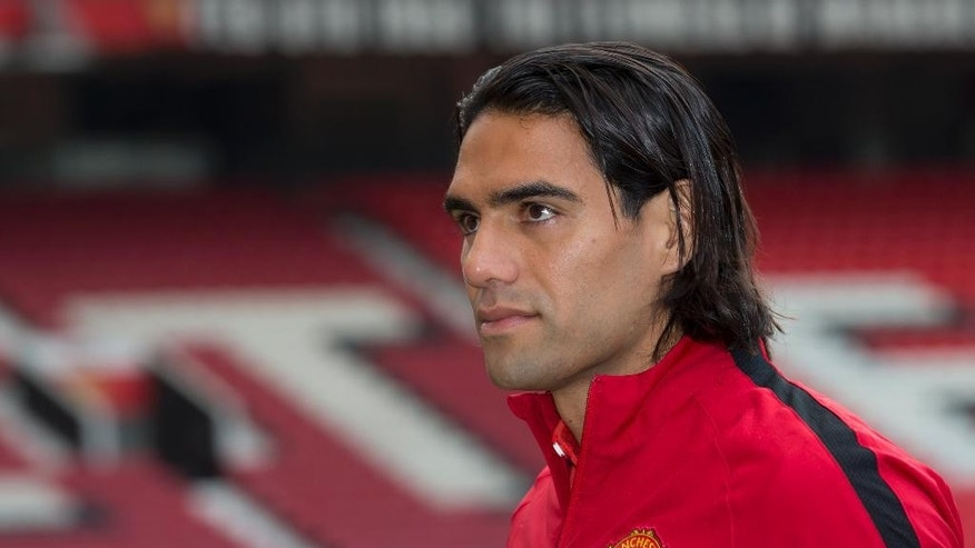 Manchester United's new player Radamel Falcao walks across the pitch at Old Trafford Stadium, Manchester, England, Thursday Sept. 11, 2014. The Colombian striker Falcao joined on a season-long loan deal from Ligue 1 side Monaco as Louis van Gaal looks to bolster his attacking options. (AP Photo/Jon Super)