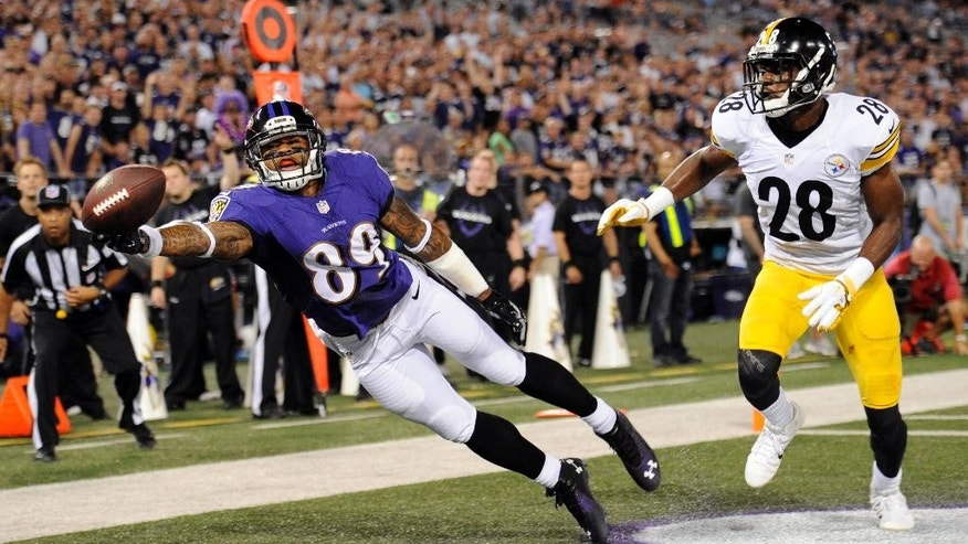Baltimore Ravens wide receiver Steve Smith (89) gets a hand on, but does not catch, a pass as Pittsburgh Steelers cornerback Cortez Allen (28) defends during the first half of an NFL football game Thursday, Sept. 11, 2014, in Baltimore. (AP Photo/Nick Wass)