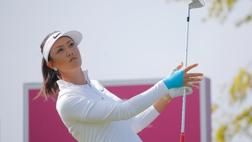 Michelle Wie, of USA, reacts as she plays on the 16th hole during the first round of the Evian Championship women's golf tournament in Evian, eastern France, Thursday, Sept. 11, 2014. (AP Photo/Laurent Cipriani)