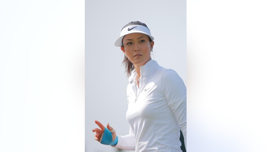 Michelle Wie, of the U.S. reacts as she plays on the 16th hole during the first round of the Evian Championship women's golf tournament in Evian, eastern France, Thursday, Sept. 11, 2014. (AP Photo/Laurent Cipriani)