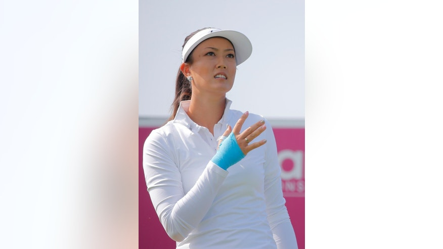 Michelle Wie, of USA, reacts after playing on the 16th hole during the first round of the Evian Championship women's golf tournament in Evian, eastern France, Thursday, Sept. 11, 2014. (AP Photo/Laurent Cipriani)