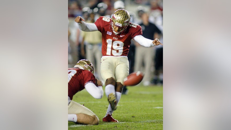 FILE - In this Saturday, Nov. 23, 2013  file photo, Florida State kicker Roberto Aguayo (19) ties an FBC record of 78 consecutive extra points in a season with this extra point in the fourth quarter of an NCAA college football game against Idaho in Tallahassee, Fla. Florida State's Roberto Aguayo sometimes roots against the Seminoles' offense. The thoughts aren't selfish, just part of a mindset that has him poised to become the most accomplished kickers in school history and one of the best ever in college football, Thursday, Sept. 11, 2014. (AP Photo/Phil Sears, File)