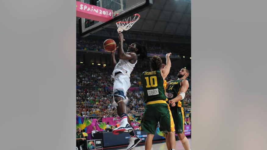 United States's Kenneth Faried goes up for a basket during the Basketball World Cup semifinal match against Lithuania at the Palau Sant Jordi in Barcelona, Spain, Thursday, Sept. 11, 2014. The 2014 Basketball World Cup competition will take place in various cities in Spain from Aug. 30 through Sept. 14. (AP Photo/Manu Fernandez)