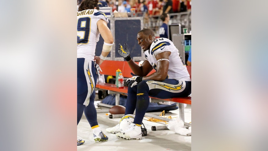 San Diego Chargers' Antonio Gates, right, talks with Danny Woodhead after the Chargers offense failed to get a first down on their final possession against the Arizona Cardinals during the second half of an NFL football game Monday, Sept. 8, 2014, in Glendale, Ariz. The Cardinals won 18-17. (AP Photo/Ross D. Franklin)