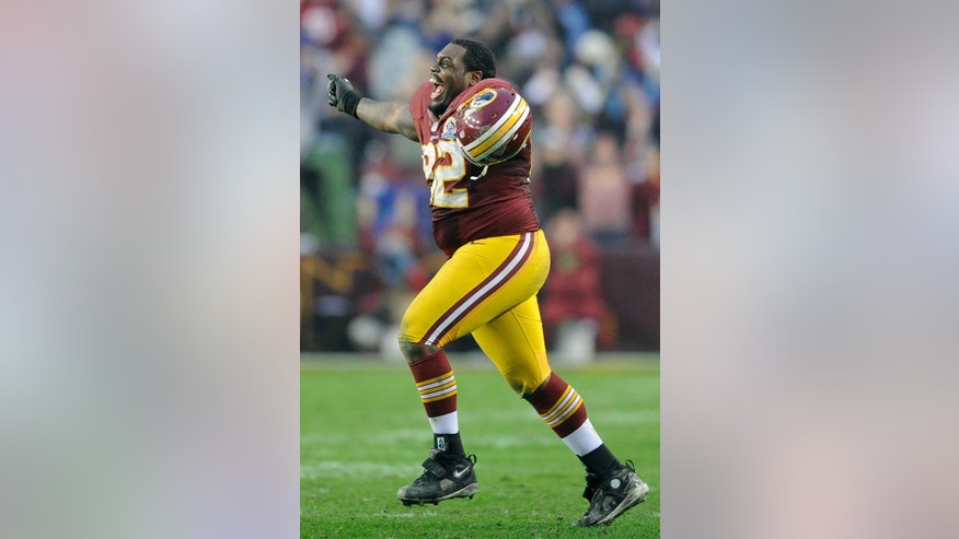 "FILE - In this Dec. 9, 2012, file photo, Washington Redskins defensive end Chris Baker reacts to victory during overtime in an NFL football game against the Baltimore Ravens in Landover, Md. Chris ""Big Wiggle"" Baker is the Redskins' life of the party. His other nickname is ""Swaggy."" When ""Big Wiggle"" gets a sack, the dance that follows is something to behold.  (AP Photo/Nick Wass, File)"