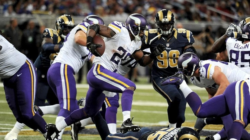 Minnesota Vikings running back Adrian Peterson runs with the ball during the fourth quarter an NFL football game against the St. Louis Rams Sunday, Sept. 7, 2014, in St. Louis. (AP Photo/L.G. Patterson)