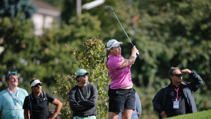 Brittany Lincicome of the US watches the flight of her ball on the sixth hole during the second round of the Evian Championship women's golf tournament in Evian, eastern France, Friday, Sept. 12, 2014. (AP Photo/Laurent Cipriani)