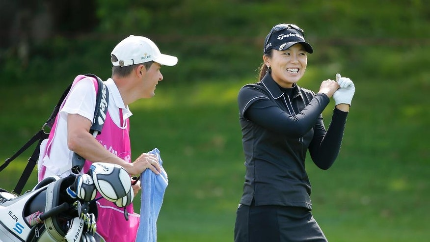 South Korea's Mi Jung Hur jokes with her caddy on the 18th hole during the second round of the Evian Championship women's golf tournament in Evian, eastern France, Friday, Sept. 12, 2014. (AP Photo/Laurent Cipriani)