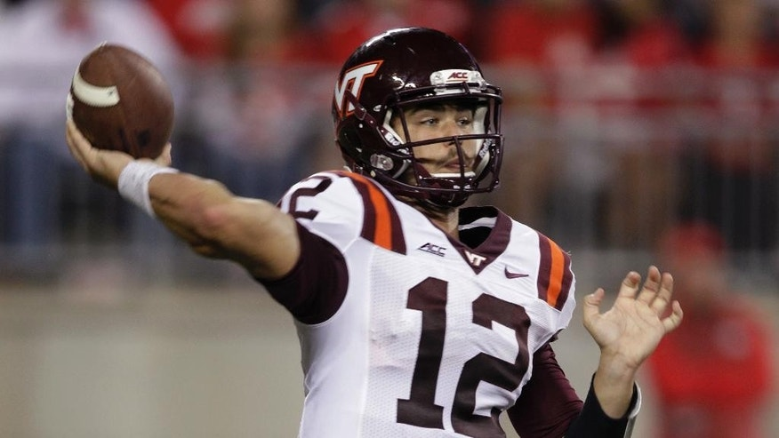 Virginia Tech quarterback Michael Brewer drops back to pass against Ohio State during the fourth quarter of an NCAA college football game Saturday, Sept. 6, 2014, in Columbus, Ohio. Virginia Tech defeated Ohio State 35-21. (AP Photo/Jay LaPrete)