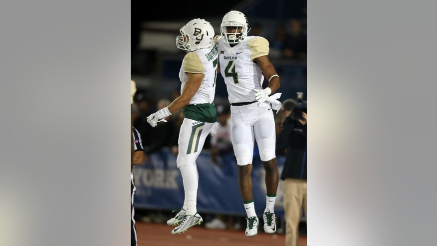 Baylor wide receiver Jay Lee (4) celebrates his touchdown with Lynx Hawthorne (7) during the first half of an NCAA college football game against Buffalo on Friday, Sept. 12, 2014, in Amherst, N.Y. (AP Photo/Mike Groll)