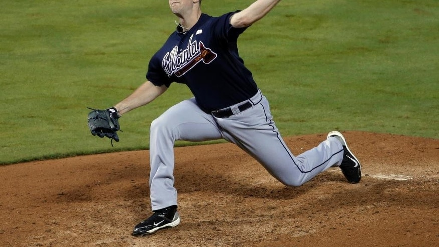 Atlanta Braves starting pitcher Alex Wood delivers to the Texas Rangers in the fifth inning of a baseball game, Friday, Sept. 12, 2014, in Arlington, Texas. (AP Photo/Tony Gutierrez)