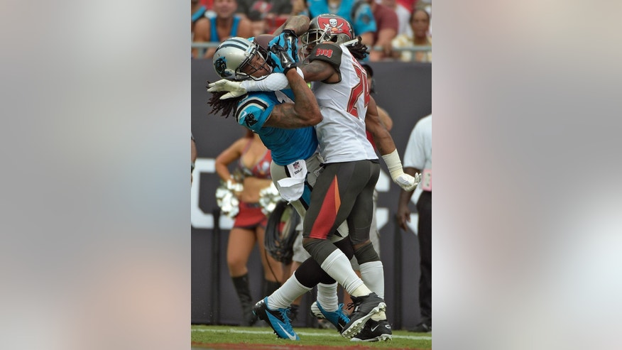 Carolina Panthers wide receiver Kelvin Benjamin (13) is tied up by Tampa Bay Buccaneers cornerback Mike Jenkins (24) after pulling in a 26-yard touchdown reception during the fourth quarter of an NFL football game Sunday, Sept. 7, 2014, in Tampa, Fla. (AP Photo/Phelan M. Ebenhack)