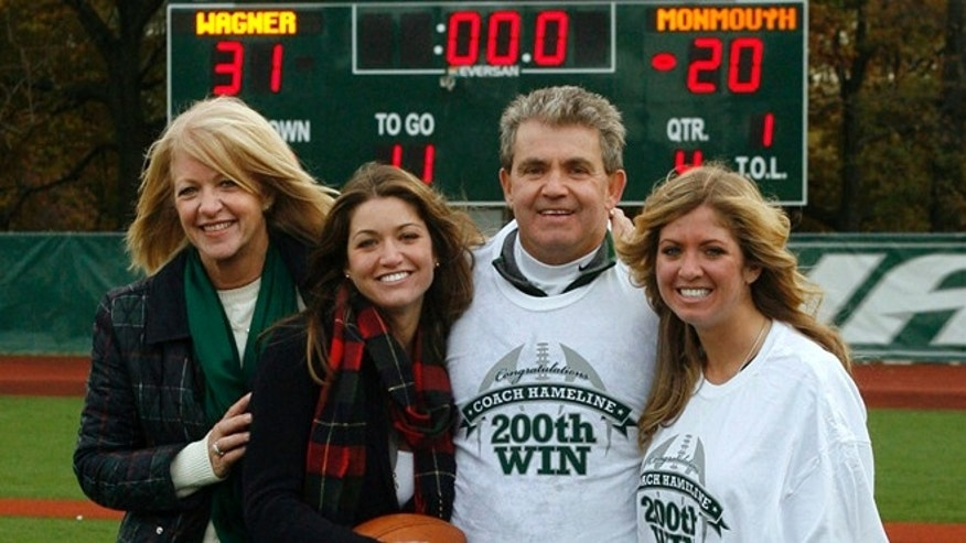 Nov. 6, 2010: Wagner football coach Walt Hameline, second from right, poses with his family, from left, wife Debi, daughters Kelly and daughter Kristin, after earnings his 200th career win after defeating Monmouth 31-20 in a college football game in the Staten Island borough of New York. (AP/Wagner College, David Saffran)