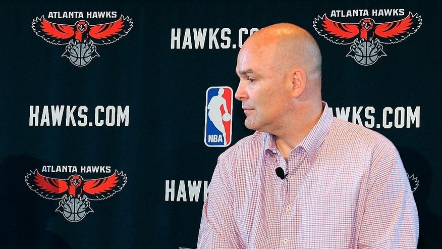FILE - In this May 29, 2013, file photo, Atlanta Hawks general managerr Danny Ferry waits during a news conference in Atlanta.   Ferry has taken an indefinite leave of absence after making racially charged comments about a potential free agent. (AP Photo/David Tulis, File)