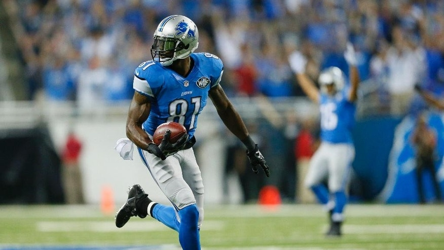 Detroit Lions wide receiver Calvin Johnson runs for a 67-yard touchdown reception in the first quarter during an NFL football game against the New York Giants in Detroit, Monday, Sept. 8, 2014. (AP Photo/Rick Osentoski)