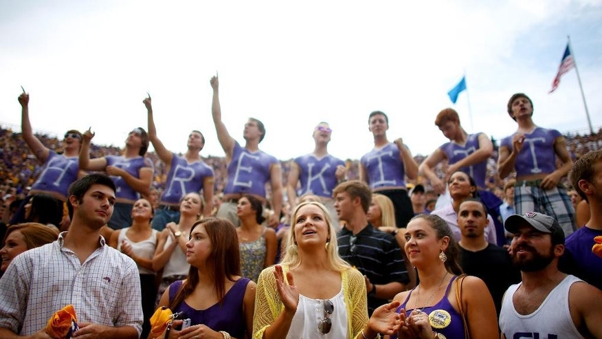 In this Sept. 6, 2014 photo, LSU fans cheer before an NCAA college football game in Baton Rouge, La. Tiger Stadium in Baton Rouge, aka Death Valley, holds more than 102,000 fans. (AP Photo/Jonathan Bachman, File)