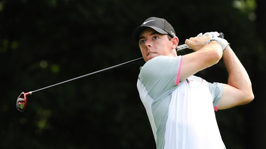 Rory Mcilroy, of Northern Ireland, hits from the tee on the third hole during the second round of play in the Tour Championship golf tournament  Friday, Sept. 12, 2014, in Atlanta. (AP Photo/John Amis)