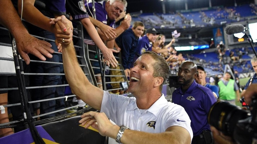 Baltimore Ravens coach John Harbaugh greets fans after an NFL football game against the Pittsburgh Steelers on Thursday, Sept. 11, 2014, in Baltimore. The Ravens won 26-6. (AP Photo/Nick Wass)
