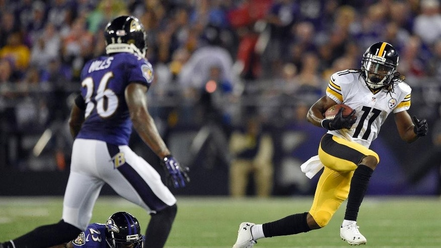 Pittsburgh Steelers wide receiver Markus Wheaton (11) runs away from Baltimore Ravens defensive back Chykie Brown (23), but strong safety Jeromy Miles (36) is waiting, during the first half of an NFL football game Thursday, Sept. 11, 2014, in Baltimore. (AP Photo/Nick Wass)