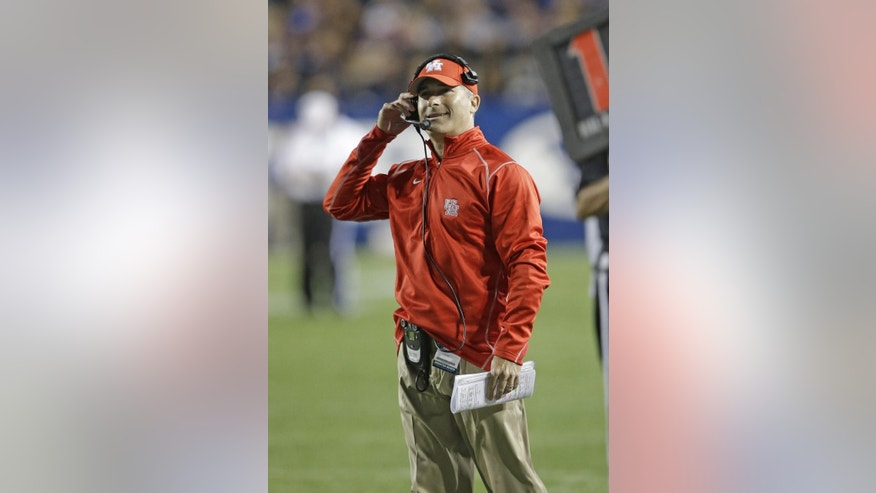 Houston head coach Tony Levine looks on in the second quarter during an NCAA college football game against BYU, Thursday, Sept. 11, 2014, in Provo, Utah.(AP Photo/Rick Bowmer)