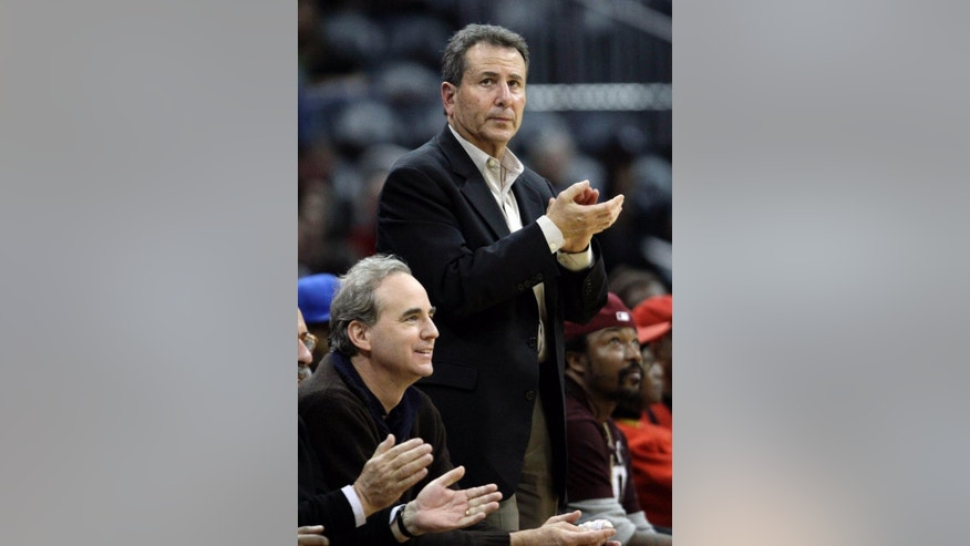 FILE - In this Dec. 22, 2010, file photo, Atlanta Hawks owners Michael Gearon Jr., left, and Bruce Levenson attend an NBA basketball game between the Hawks and the Cleveland Cavaliers in Atlanta. Hawks general manager Danny Ferry has been disciplined by CEO Steve Koonin for making racially charged comments about Luol Deng when the team pursued the free agent this year. The team did not provide any details of the discipline. (AP Photo/David Goldman, File)