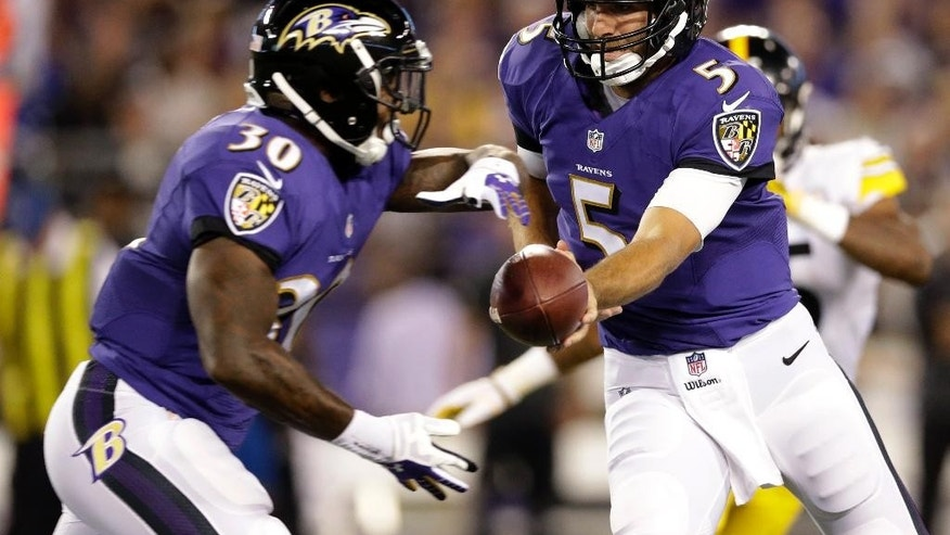 Baltimore Ravens quarterback Joe Flacco (5) hands the ball off to running back Bernard Pierce (30) during the first half of an NFL football game against the Pittsburgh Steelers on Thursday, Sept. 11, 2014, in Baltimore. The Ravens won 26-6. (AP Photo/Patrick Semansky)