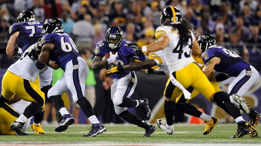 In this photo taken on Thursday, Sept. 11, 2014, Baltimore Ravens running back Bernard Pierce, center,  runs the ball during a NFL football game against the Pittsburgh Steelers in Baltimore. If Pierce keeps this up, he soon might be known as a premier NFL running back. For now, the third-year pro carries this label: The Man Who Replaced Ray Rice.  (AP Photo/Gail Burton, File)