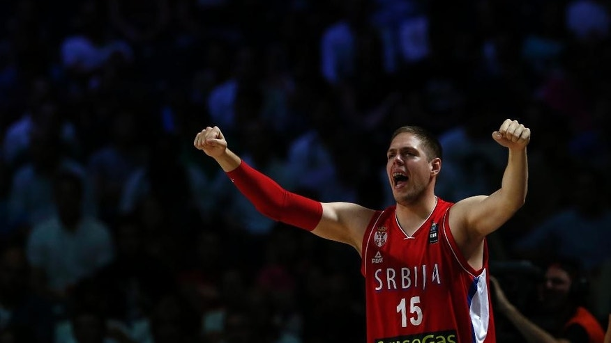 Serbia's Vladimir Stimac reacts from the bench during a basketball World Cup semifinal match between France and Serbia at the Palacio de los Deportes stadium in Madrid, Spain, Friday, Sept. 12, 2014. (AP Photo/Daniel Ochoa de Olza)