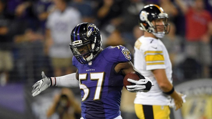 Baltimore Ravens inside linebacker C.J. Mosley (57) celebrates his fumble recovery, near Pittsburgh Steelers quarterback Ben Roethlisberger (7) during the second half of an NFL football game Thursday, Sept. 11, 2014, in Baltimore. The Ravens won 26-6. (AP Photo/Nick Wass)