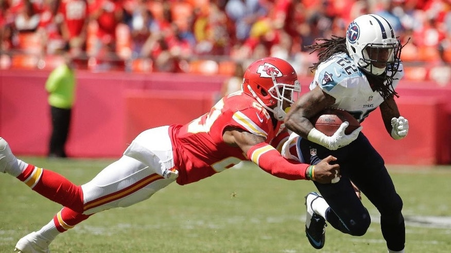 Tennessee Titans running back Dexter McCluster (22) breaks a tackle by Kansas City Chiefs safety Eric Berry (29) in the second half of an NFL football game in Kansas City, Mo., Sunday, Sept. 7, 2014. (AP Photo/Charlie Riedel)