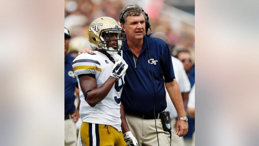 Georgia Tech head coach Paul Johnson speaks to Tony Zenon (9) during the first half of an NCAA college football game against the Georgia Southern, Saturday, Sept. 13, 2014, in Atlanta. (AP Photo/Mike Stewart)