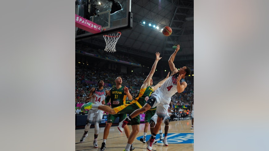 United States' Stephen Curry, right, pushes the ball up to the basket against Lithuania's Adas Juskevicius during their Basketball World Cup semifinal match at the Palau Sant Jordi in Barcelona, Spain, Thursday, Sept. 11, 2014. The 2014 Basketball World Cup competition will take place in various cities in Spain from Aug. 30 through Sept. 14. (AP Photo/Manu Fernandez)