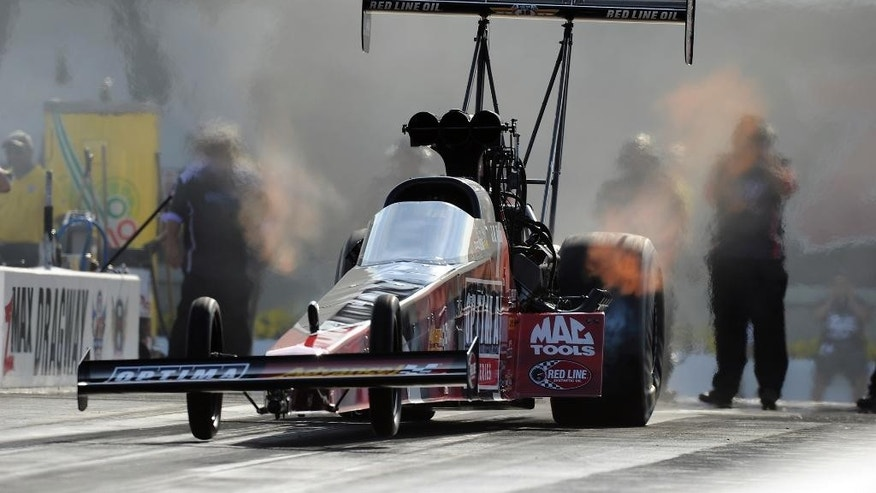 In this photo provided by the NHRA, J.R. Todd qualifies No. 1  in Top Fuel at the Pep Boys NHRA Carolina Nationals drag races at zMAX Dragway on Saturday, Sept. 13, 2014, in Concord, N.C. Todd will face Clay Millican in the first round of eliminations. (AP Photo/NHRA, Marc Gewertz)