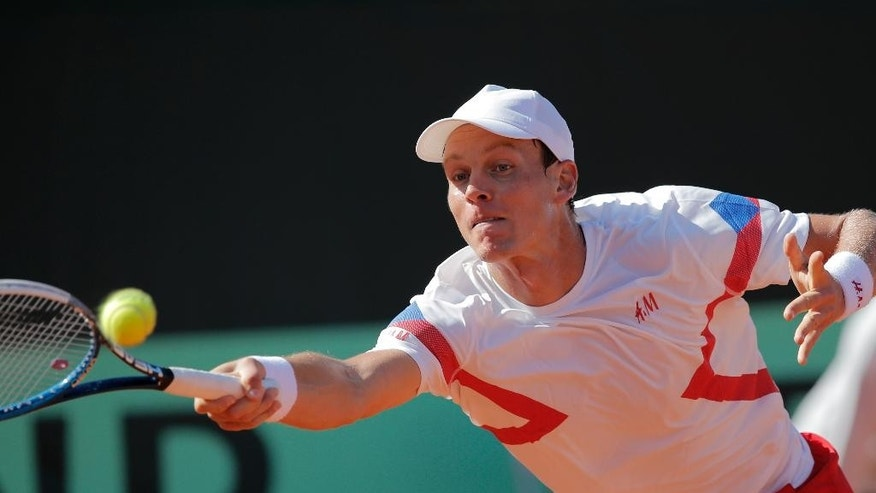 Tomas Berdych of the Czech Republic returns the ball against France's Richard Gasquet during their single match in the semifinal of the Davis Cup at the Roland Garros stadium, in Paris, Friday, Sept. 12, 2014. (AP Photo/Christophe Ena)