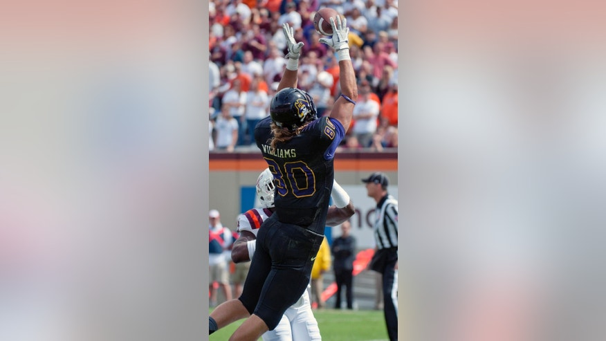 East Carolina's Bryce Williams catches a pass in the end zone for a touchdown during an NCAA college football game against Virginia Tech,  Saturday, Sept. 13, 2014, in Blacksburg, Va. (AP Photo/Don Petersen)