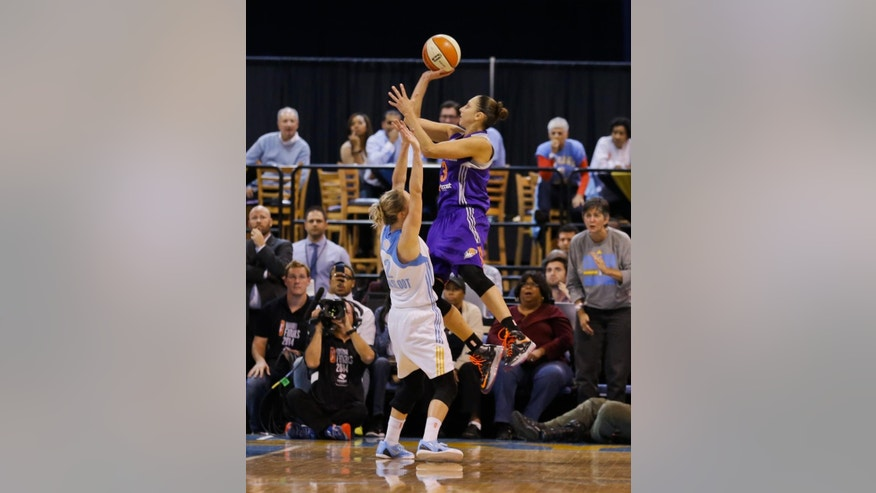 Phoenix Mercury guard Diana Taurasi shoots and is fouled by Chicago Sky guard Courtney Vandersloot (22) during the second half of Game 3 of the WNBA Finals basketball series, Friday, Sept. 12, 2014, in Chicago. The Mercury won 87-82 and swept the series. (AP Photo/Kamil Krzaczynski)