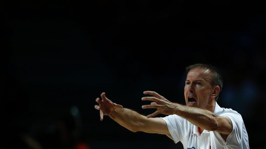 France's coach Vincent Collet reacts to his players during the 3rd place final of the World Basketball between France and Lithuania at the Palacio de los Deportes stadium in Madrid, Spain, Saturday, Sept. 13, 2014. (AP Photo/Andres Kudacki)