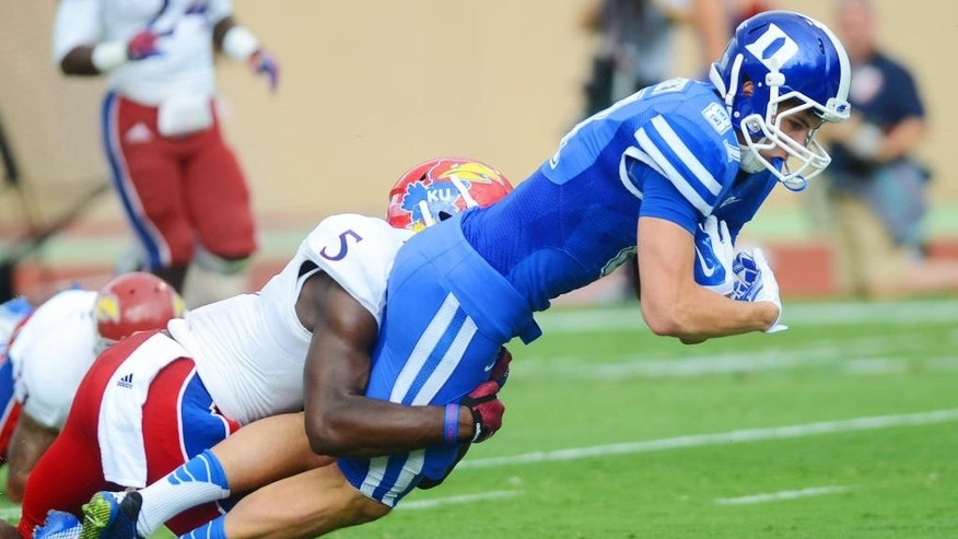 Duke's Max McCaffrey (87) scores a touchdown against Kansas' Isaiah Johnson (5)  during the first half of an NCAA college football game, Saturday, Sept. 13, 2014, in Durham, N.C. (AP Photo/The Herald-Sun Bernard Thomas)