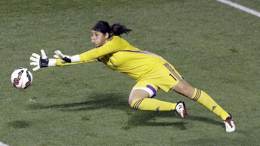 Mexico goalkeeper Cecilia Santiago (1) makes a save against the United States in the first half of an international friendly soccer match at Rio Tinto Stadium, Saturday, Sept. 13, 2014, in Sandy, Utah. (AP Photo/Rick Bowmer)
