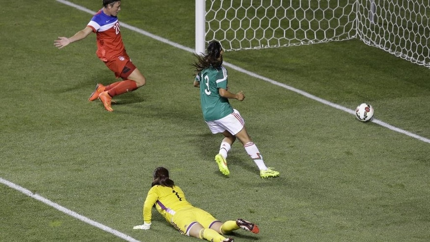 United States' Abby Wambach (20) scores as Mexico defender Bianca Sierra (13) and goalkeeper Cecilia Santiago (1) look on in the first half of an international friendly soccer match at Rio Tinto Stadium Saturday, Sept. 13, 2014, in Sandy, Utah.  (AP Photo/Rick Bowmer)